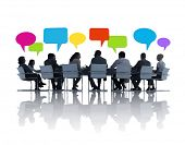 picture of recommendation  - Group of Business People at Meeting Table with Speech Bubbles - JPG