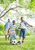 stock photo of pre-adolescent child  - African Father and Sons Playing Football - JPG