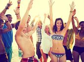 stock photo of bonding  - Young People Dancing at Summer Beach Party - JPG