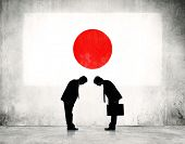 picture of japanese flag  - Businessmen Bowing at Japanese Flag - JPG