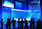 stock photo of flow  - Silhouette of Stock Market Discussion  - JPG