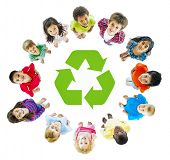 foto of pre-adolescent child  - Diverse Children Standing in Circle Around Recycling Symbol - JPG