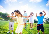 stock photo of hula hoop  - Family Playing in a Park - JPG