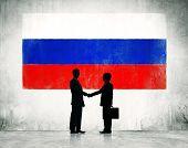 stock photo of entrepreneurship  - Business Handshake With Flag of Russia - JPG