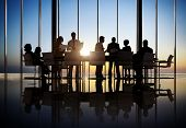 stock photo of sunrise  - Business People Working In a Conference Room - JPG