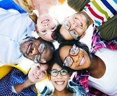 stock photo of bonding  - Group of Diverse Colorful Friends With Their Heads Together - JPG