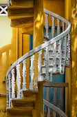 picture of balustrade  - white spiral stairs balustrades with yellow walls - JPG
