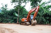 stock photo of earth-mover  - Heavy earth mover at construction site home - JPG