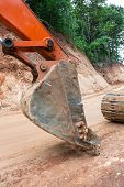 image of earth-mover  - Heavy earth mover at construction site home - JPG