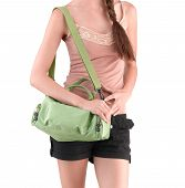 stock photo of carry-on luggage  - A young woman carrying a green canvas handbag - JPG
