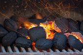 stock photo of charcoal  - Charcoal briquettes ready for barbecue or grill party - JPG