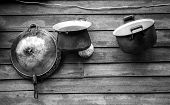 foto of smut  - Kitchenware Old on background Natural wood board - JPG