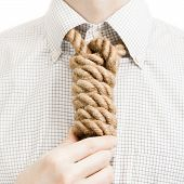 stock photo of gallows  - Businessman with gallow rope over his neck  - JPG