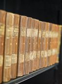 Row of worn Antique books