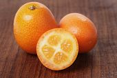 picture of kumquat  - fresh kumquat on wood table close up photo - JPG