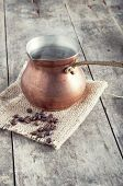 picture of pot roast  - roasted coffee beans and copper coffee pot on table - JPG