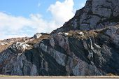 stock photo of gneiss  - This rock face is on the A894 in North West Scotland - JPG