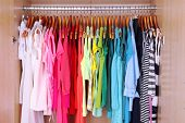 pic of wardrobe  - Colorful clothes hanging in wardrobe - JPG