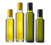 stock photo of virginity  - Set bottles of virgin olive oil on a white ground - JPG