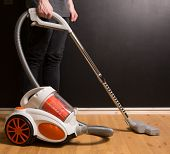 Cleaning With Vacuum Cleaner In Living Room