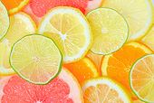 stock photo of flavor  - fresh Sliced citrus fruits background - JPG