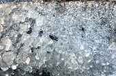 stock photo of stalagmite  - transparent ice stalagmites pattern structure close up - JPG