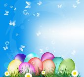 stock photo of duck egg blue  - Easter Eggs on the green grass - JPG