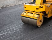 stock photo of paving  - Crew putting down a coat of asphalt at an apartment comples - JPG