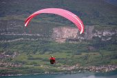 stock photo of annecy  - paraglider flying over Annecy countryside in France
