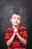 stock photo of piety  - Innocent devil - JPG