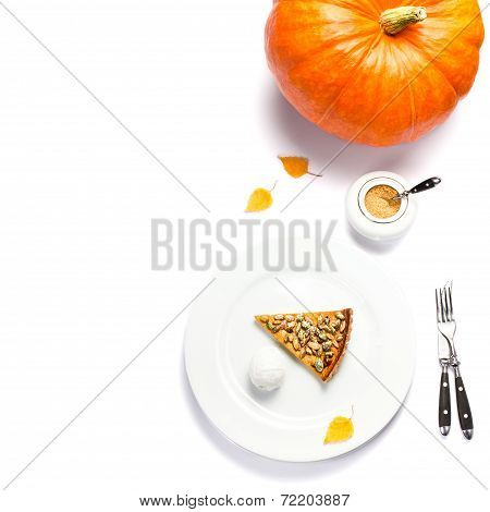 Slice Of Fresh Pumpkin Pie With Whipped Cream And Pumpkin Seeds On White Plate Isolated On White Bac