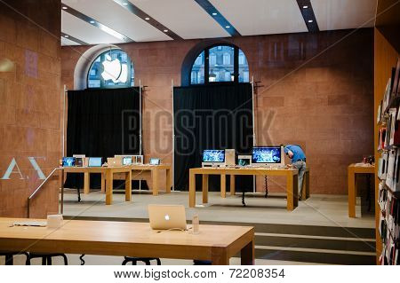 STRASBOURG FRANCE - SEPTEMBER 18 2014: Apple Store with working Apple Genius Employee and covered shopping windows with black fabric curtains to protect the store rearrangement for the iPhone 6 launch.