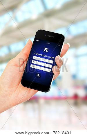 Hand Holding Mobile Phone With Flights Search Application
