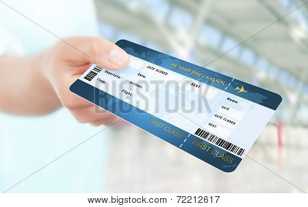 Hand Holding Air Ticket On Airport