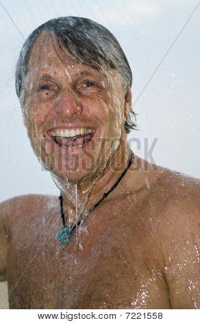happy laughing man taking shower