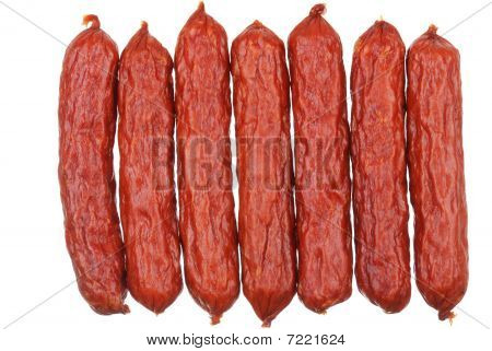 Group Of Tasty Sausages On White