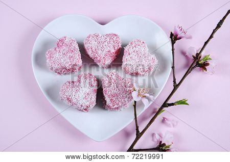 Homemade Australian Style Pink Heart Shape Small Lamington Cake On Heart Shape White Plate With Spri