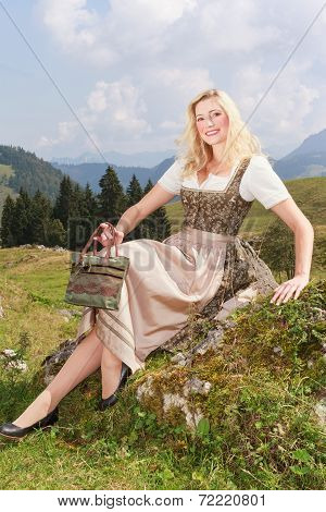 Young attractive woman in dirndl