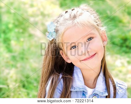 Portrait Of Adorable Smiling Little Girl