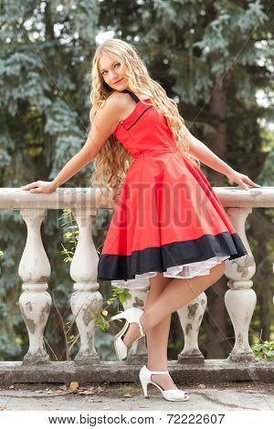 Woman Poses in Red Dress