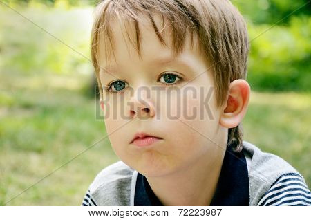Little Boy Indifferently Looking Away
