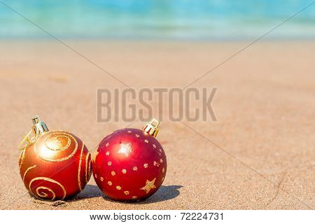 Two Red Christmas Ball On The Beach