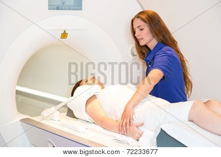 Medical Technical Assistant Preparing Scan Of Shoulder With Mri