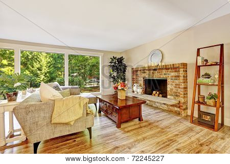 Spacious Bright Living Room With Glass Wall And Brick Fireplace