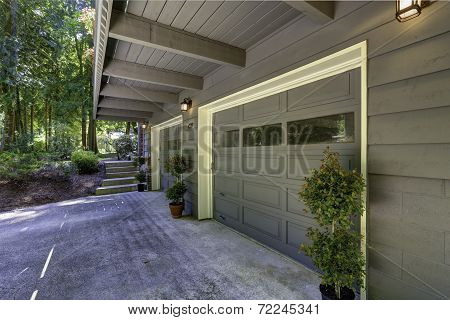 House Exterior. Two Car Garage With Driveway