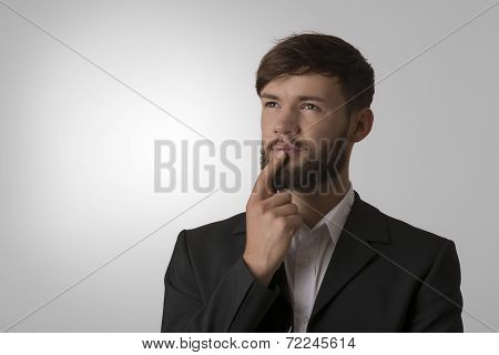 Thinking Young Man In Suit