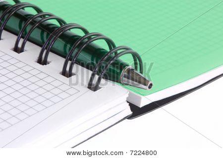 Open Notebook And Green Pen