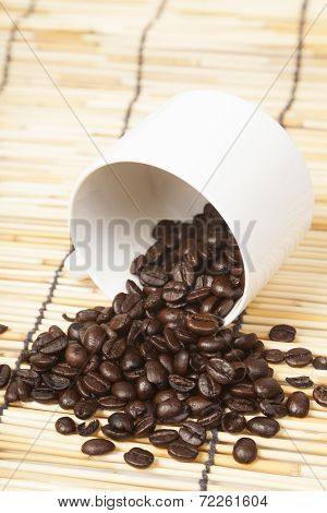 White Coffee Cup With Coffee Beans.