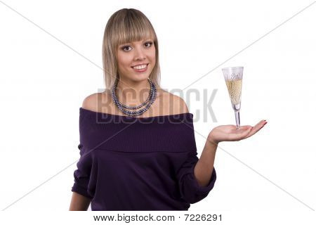 Woman Is Holding A Glass Of White Wine