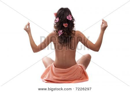 Woman Sitting Back With Orchid In Hair